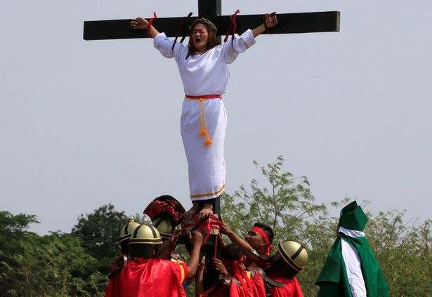 Easter: Filipino Catholics Nail Themselves To Wooden Crosses To Mark Holy Week 6