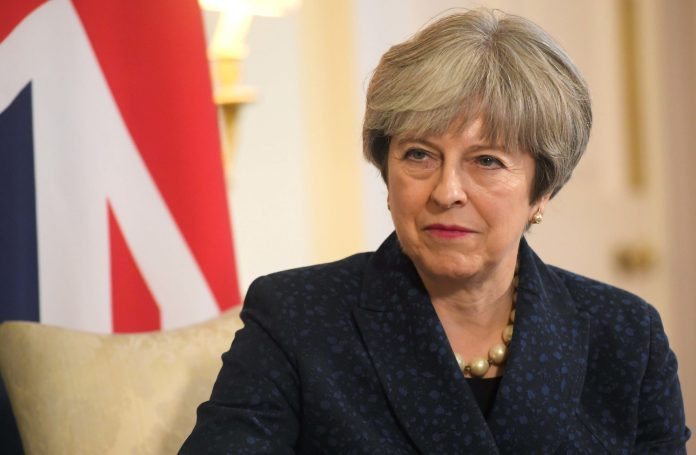 UK Prime Minister, Theresa May, Ban The Entire British Government From Attending The 2018 World Cup In Russia Over Spy Poisoning 3