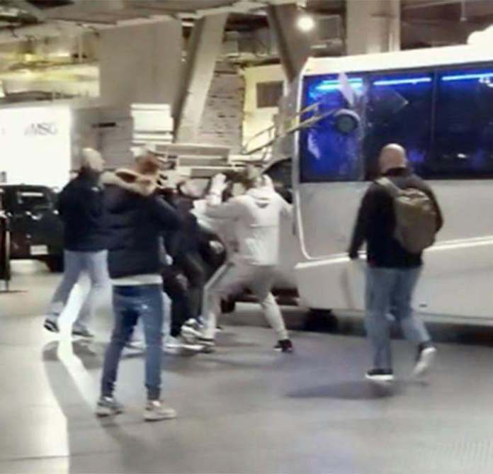 Conor McGregor Hands Himself In To NYPD After Attacking Khabib Nurmagomedov's Coach  1