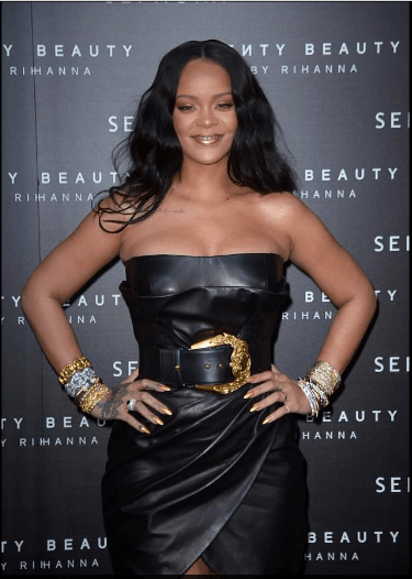 Style Stalking: Rihanna Wows In Cleavage-Baring leather Dress For Fenty Beauty Launch In Italy 3