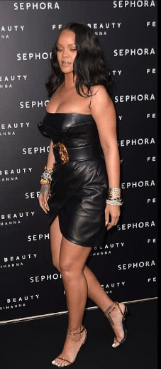 Style Stalking: Rihanna Wows In Cleavage-Baring leather Dress For Fenty Beauty Launch In Italy 5