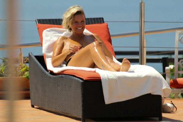 Still Need An Uplift! Former Singer Kerry Katona Sunbathes Topless On Holiday In Marbella 5