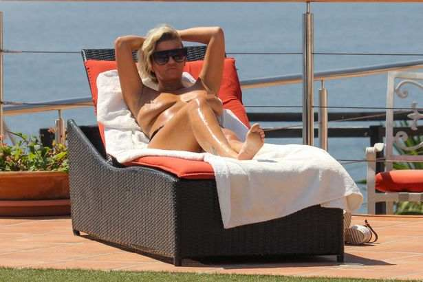 Still Need An Uplift! Former Singer Kerry Katona Sunbathes Topless On Holiday In Marbella 7