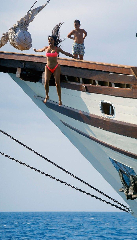 Style Stalking: Kim Kardashian Flaunts Her Underboob In Pink Bikini As She Poses On A Yacht 3