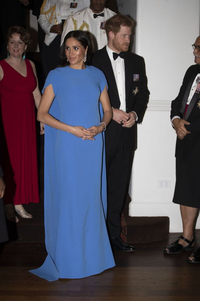 Who What Wear: Meghan Markle Flaunts Her Growing Baby Bump In Cape-sleeved Sefiya Gown 2