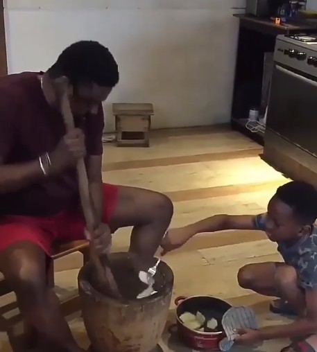 So Sweet! Kunle Afolayan Teaches His Son How To Pound Yam 1