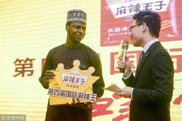 Champion! Nigerian Man Wins Pepper Eating Contest In China 2