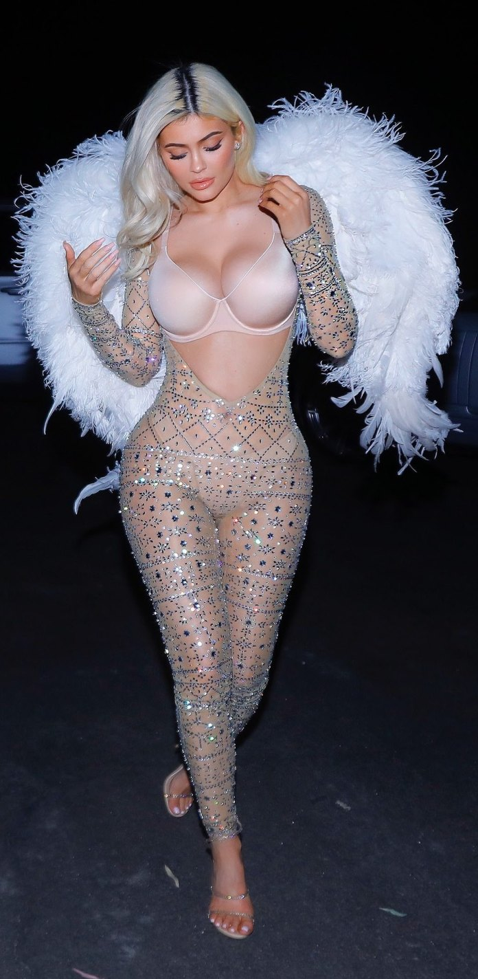 Kardashians/Jenner Sister Show Off Their Incredible Figures In Barely There Halloween Costumes 1