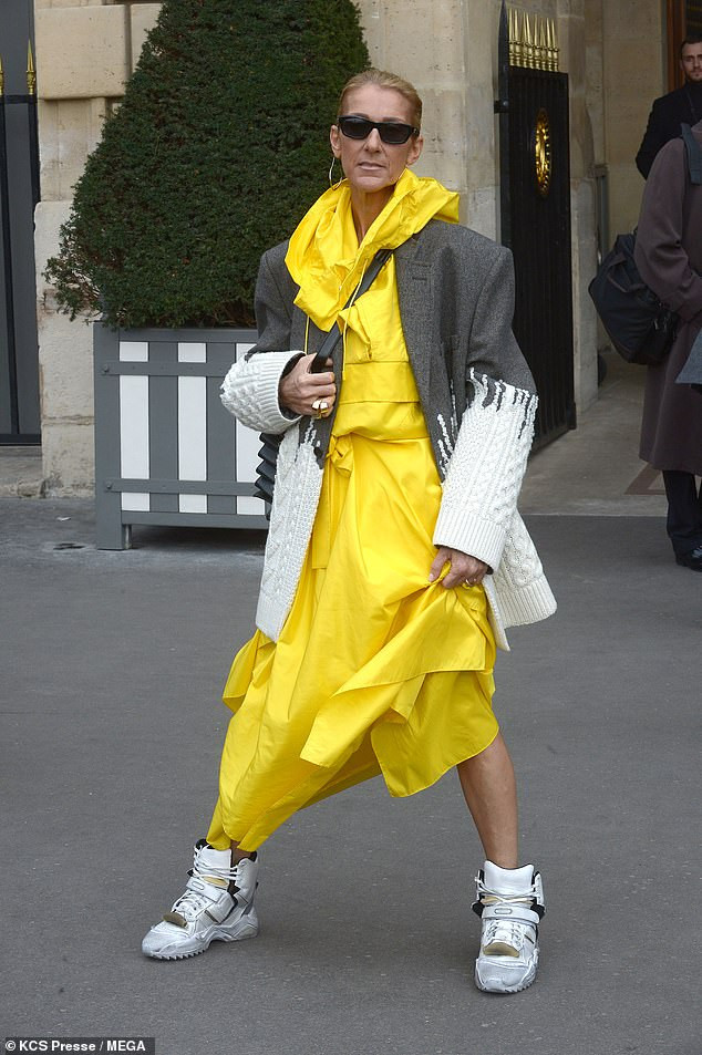 Celine Dion Makes Another Strong Fashion Statement In Yellow Coat, Hybrid Jacket And Gold Trainers 3