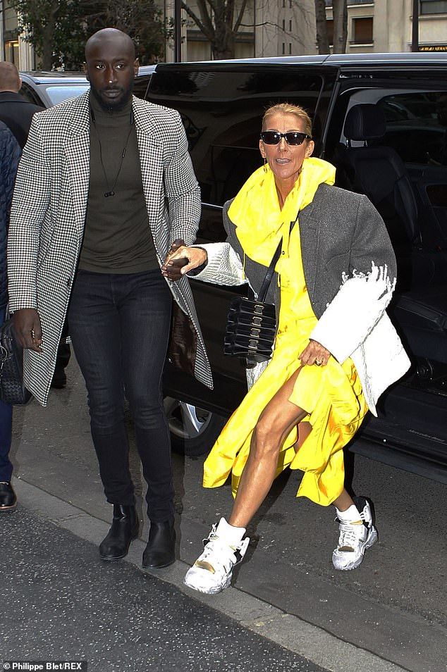 Celine Dion Makes Another Strong Fashion Statement In Yellow Coat, Hybrid Jacket And Gold Trainers 2