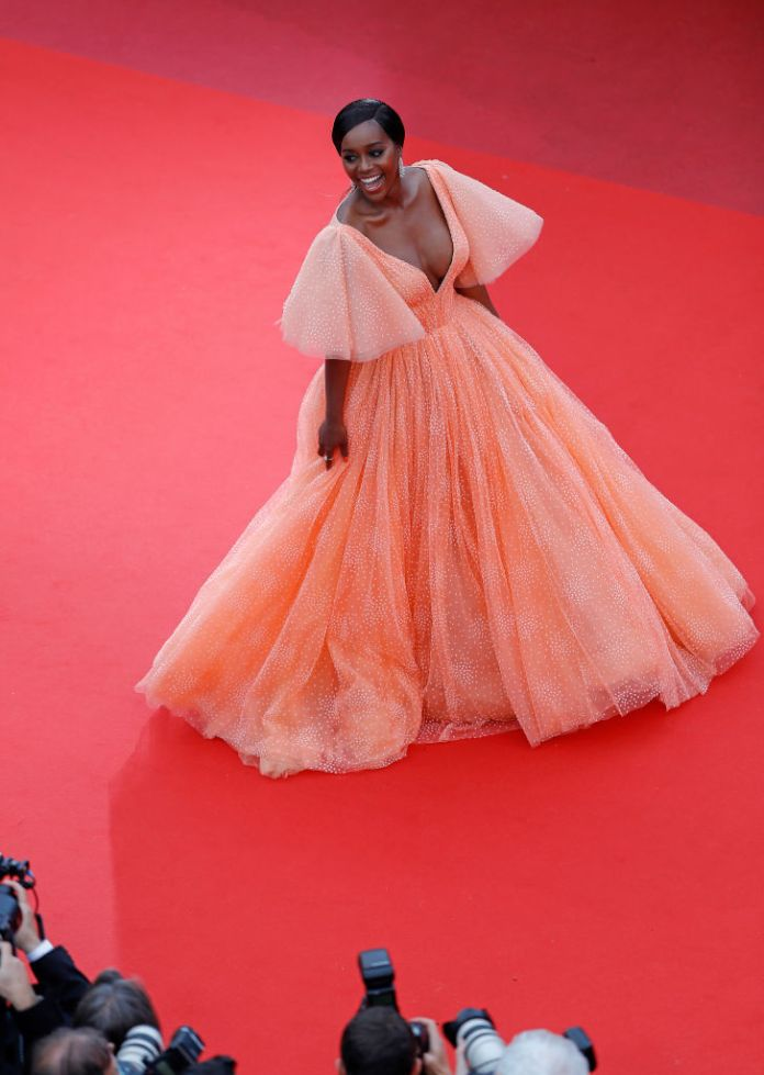 Black Princess! Aja Naomi King Looks Sensational In A Coral Zac Posen Gown At Cannes 2