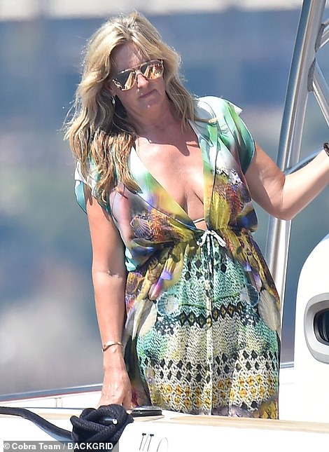 Penny Lancaster Is An Example Of Colour In Patterned Bikini And Kimono