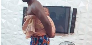 Daddy Duty! Deyemi The Actor Is The Real Dad As He Straps Baby To Back In New Photo
