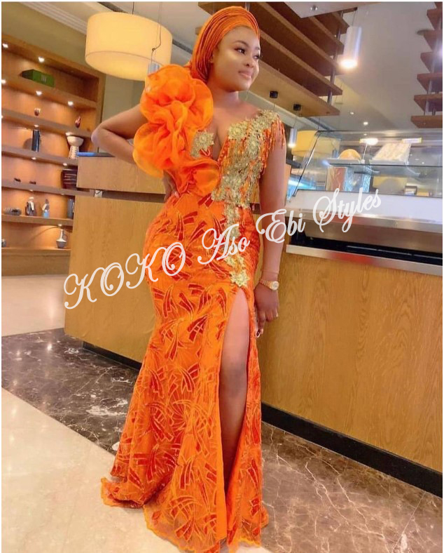 Slay Your Queenship In These Daring Slit Aso Ebi Styles 4