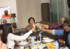 Erica, Dele Momodu and others at a table
