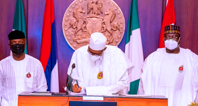 President Buhari Signs 2021 Budget, Finance Bill Into Law