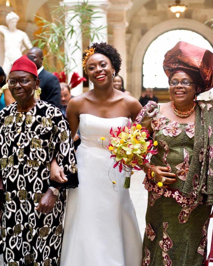 Chimamanda Adichie and parents on wedding day