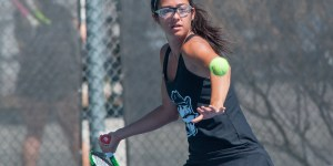 Aggie sophomore Clara Rizea sets up to return the ball during the women's tennis Aggie Invitational on Sunday, Sept. 23, at the NMSU Tennis Center. (Photo by Eric Burnside/Kokopelli)