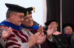 New Mexico State University President John Flores, left, and Chancellor Dan Arvizu talk to one another between speakers during their inauguration event Thursday, Nov. 15, 2018. (Photo by Josh Bachman courtesy of the Las Cruces Sun-News)