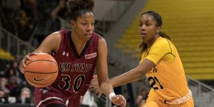 Aggie junior guard Gia Pack dribbles past a defender during the 2017-18 season. (Photo courtesy of NMSU athletics)
