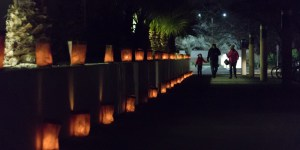 A family strolls the luminaria-filled NMSU campus during the 34th annual Noche de Luminaries event, Sunday Dec. 2, 2018. (Photo by Garrett Tucker/Kokopelli)