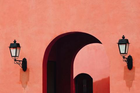 Living Coral color background, Exterior building with entrance and lamp