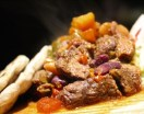 Texas styled slow cocked beef, beans and chili stew with pan bread