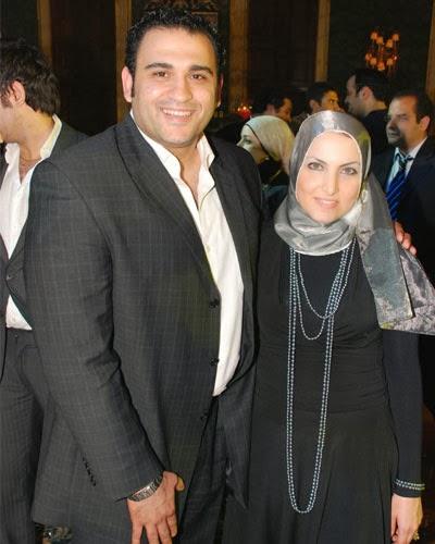 أكرم حسني وزوجته