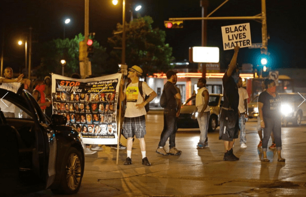 protesters and police in Milwaukee2