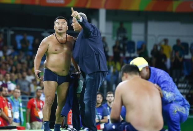 The coaches of Mandakhnaran Ganzorig stripped down to their skinnies in protest1.jpg