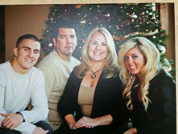 Brandon Ellingson, his parents and sister1.jpg