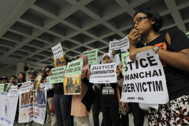 migrant-workers-alliance-protest-the-killings-of-two-indonesian-women-outside-the-hong-kong-high-court-in-oct-2014