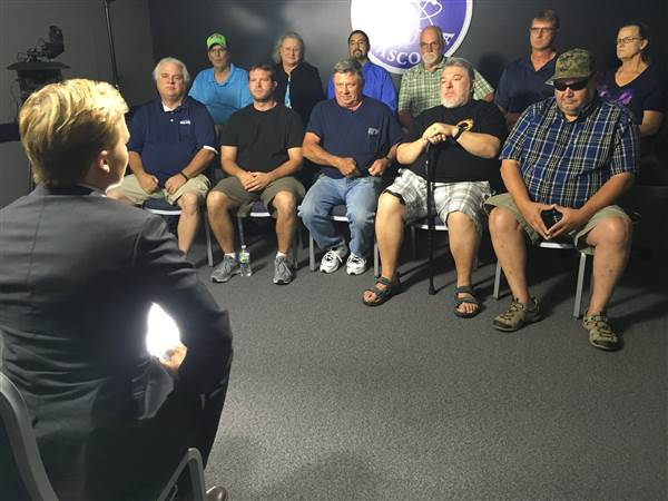 Ronan Farrow with current and former workers from the Hanford Nuclear plant1.jpg