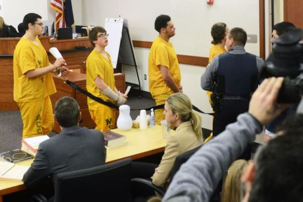 bradley-renfro-second-from-left-speaks-as-he-leaves-court-in-the-david-grunwald-murder-case2