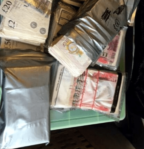 Cash that was seized by police during the raid on the family.png