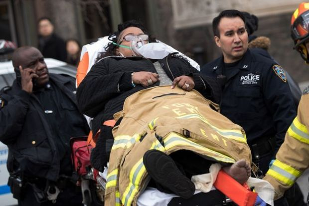 first-responders-carry-an-injured-person-away2