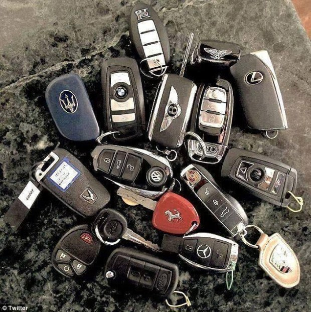 One of Guzman's sons shows of a selection of keys to his cars.jpg
