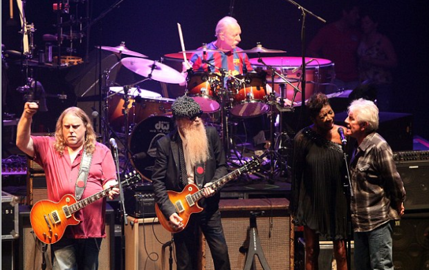 The Allman Brothers Band performing on stage.png