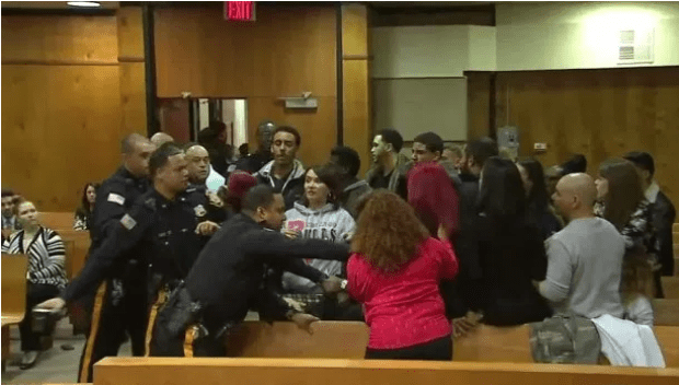 But a police officer stepped in and grabbed it away from her before she could proceed .png