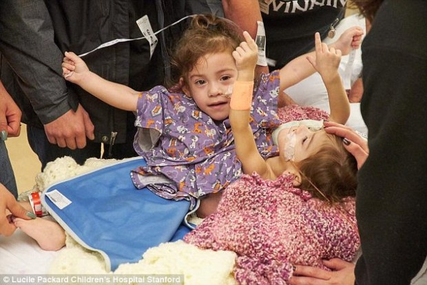 Eva [Left], and Erika [Right], pictured arriving at the hospital for their landmark separation the surgery in January
