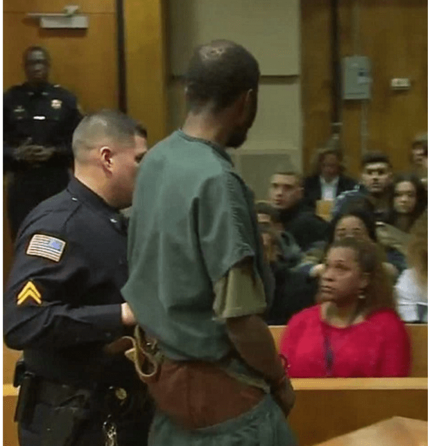 Gerry Thomas one of the co-defendants stares at the court gallery during his bond .png