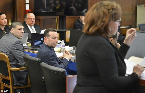 Hernandez listens to defense attorney Linda Kenney Baden (right) question ballistics experts during testimony on Monday
