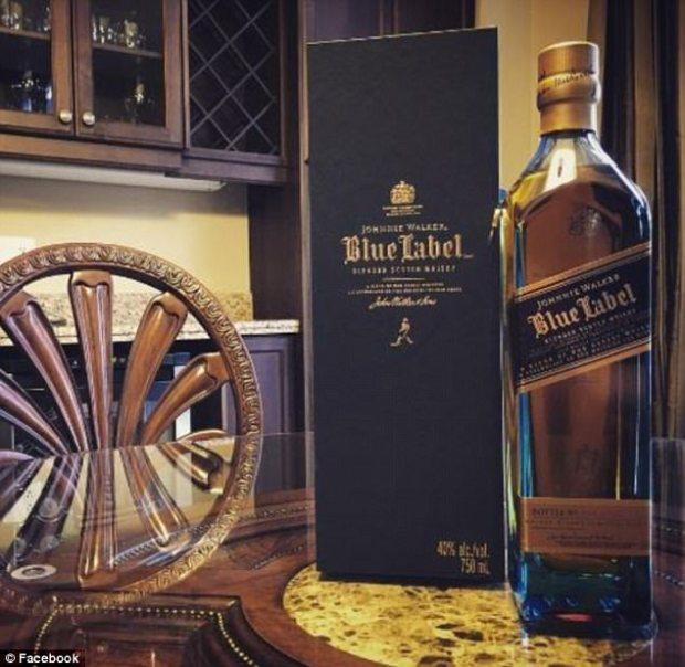 Make money, enjoy an expensive lifestyle including a quarter century old bottle of whiskey.jpg
