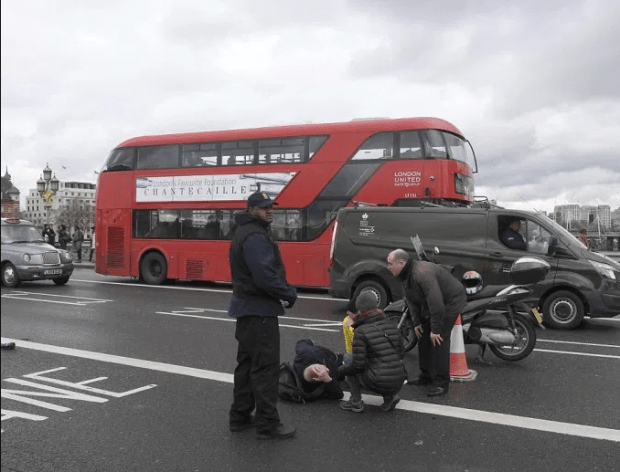 pedestrian lies stricken on Westminster Bridge after reports a car knocked down people near the Houses Parliament.png
