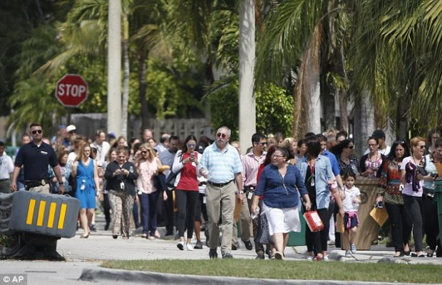 People are evacuated from the David Posnack Jewish Community Center in Davie, Florida, on February 27 after a bomb threat. Thompson allegedly made threats against eight Jewish institutions in the name of a former lover.jpg