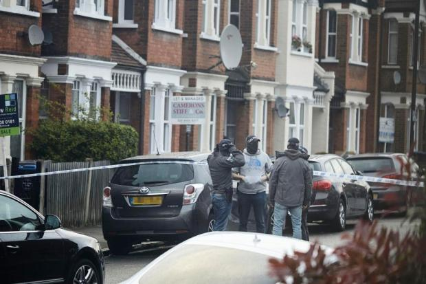 Cops sealed off the area in Willesden North London, as they swooped at about 7pm.jpg