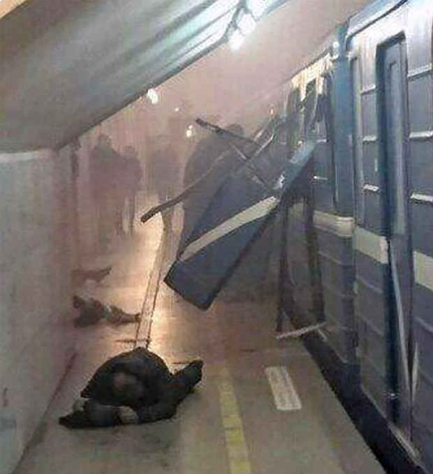Injuredman lies down on the platform after a bomb blast rips through a Metro carriage in the city of St Petersburg