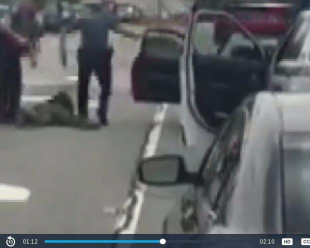Officer Robert McDonald stomping Hollins.png