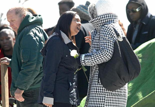 Mourners confron each other at Omar Murray's graveside during the burial on March 9, 2013.jpg