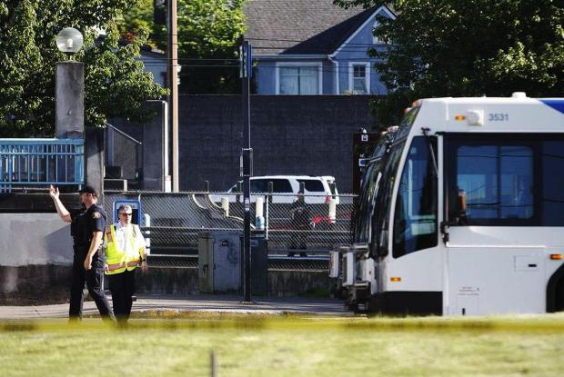 Police investigate a deadly stabbing on a Metropolitan Area Express train Friday in northeast Portland, Ore2.jpg